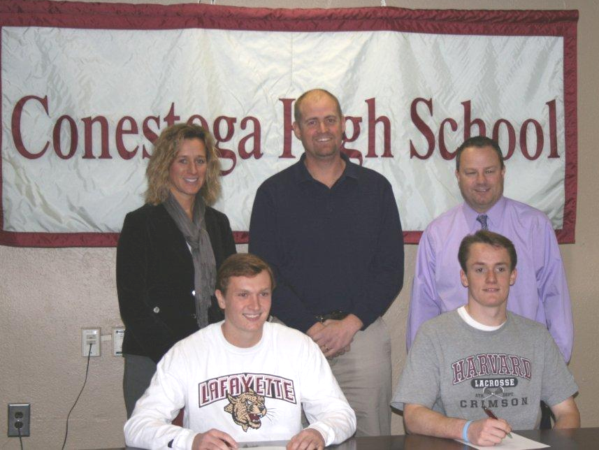 Two Conestoga boys' lacrosse players recently committed to colleges. From left are: (back row) Amy Meisinger, Conestoga Principal; Brian Samson, Conestoga Head Coach; Patrick Boyle, Conestoga Athletic Director; (front row) Alex Mezey (committed to Lafayette); Jake Scott (Harvard).