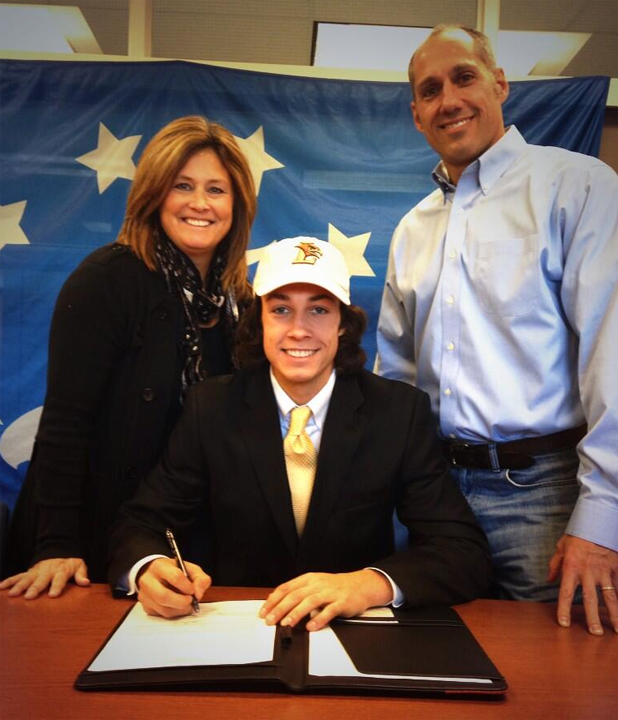 Bo Lori signs with Lehigh flanked by his parents