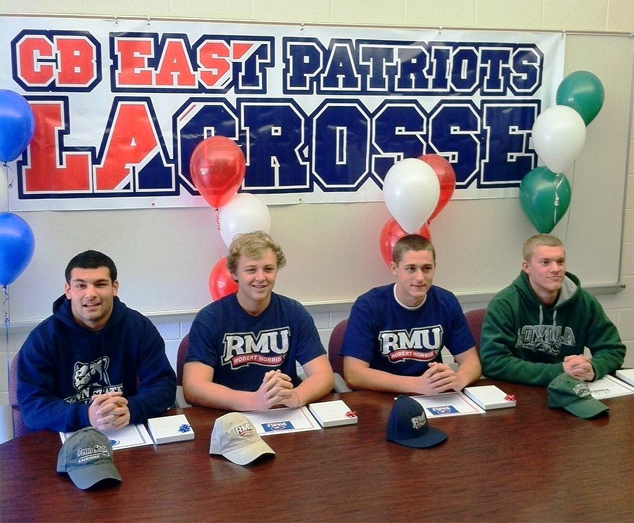 CB East Men's Lacrosse ink Division I NLI's. From Left to Right: Tyler Butler (D/LSM) Pennsylvania State University Matt Schmidt (A) Robert Morris University Will Dempster (D) Robert Morris University Matt Heim (M) Loyola University