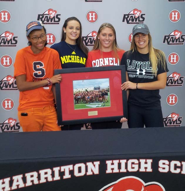 From left, Harriton's Melina Avery (Syracuse, goalie), Katie Melvin (Michigan, attack), Hilary Lemonick (Cornell, defender), and Sabrina Tabasso (Loyola, midfielder) show off a photo of their state championship.