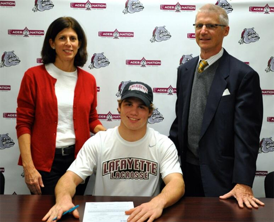Jack Kane! Pictured with his parents as he signed his NLI with Lafayette College to play lacrosse!