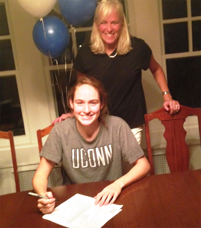 Kristen Hansen is pictured signing her NLI with  her mother Becky Welsh.