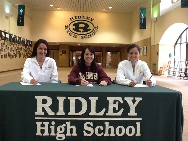 Three Ridley High School girls inked NLI's to Division II schools last week. From L – R   Sam Brennan – Millersville Hayley Kilian – Lock Haven Liz Brennan - Millersville