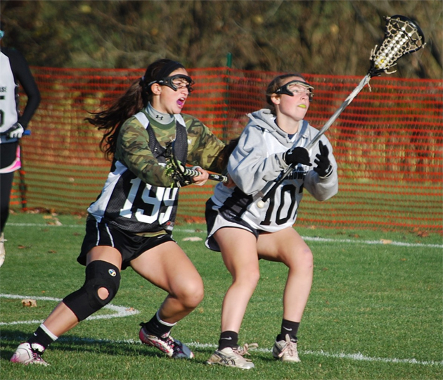Samantha Scarpello (left) of Seneca defends Meghan Corcoran of Simsbury (CT)