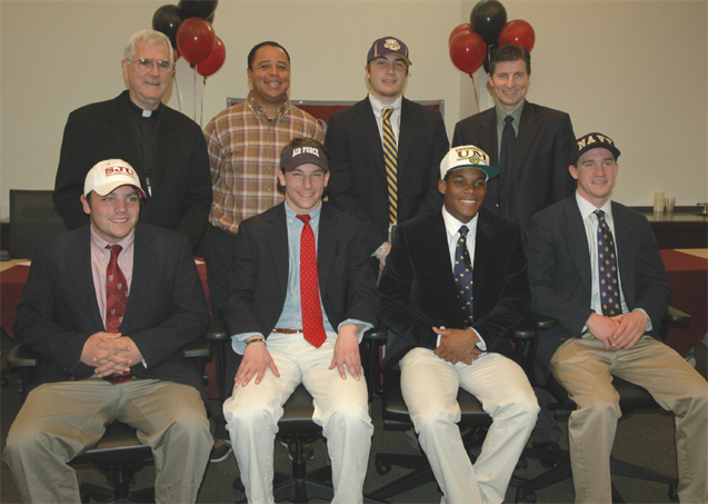 St. Joe's Prep signing: (Standing, L-R) President Rev. George Bur, S.J., Coach Eric Gregg, Andrew Benedict, Principal Jason Zazyczny (Sitting, L-R) Scott Scheuerle, Chuck Goldstein, Chase Young, Pat Walsh