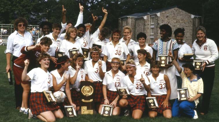 Tina Sloan Green, seen at the top right, celebrates an NCAA championship with her team