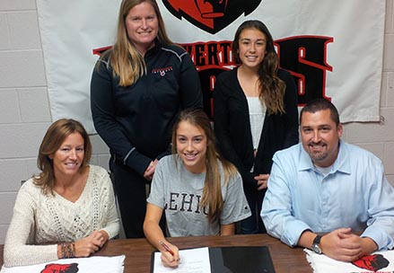 Boyertown senior Haley Wentzel, flanked by her parents Beth and Jeff Wentzel, signs a national letter of intent to play Division I lacrosse at Lehigh University during a recent signing ceremony at the high school. Also on hand for the event were, standing from left, Boyertown coach Pam Wernersbach and Haley's sister Hannah.