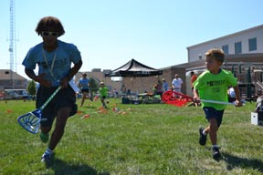 Director of Cradle Lacrosse Dyland Brown, left, and Cradler Teddy at last summer's Cradle camp in Avalon, N.J.