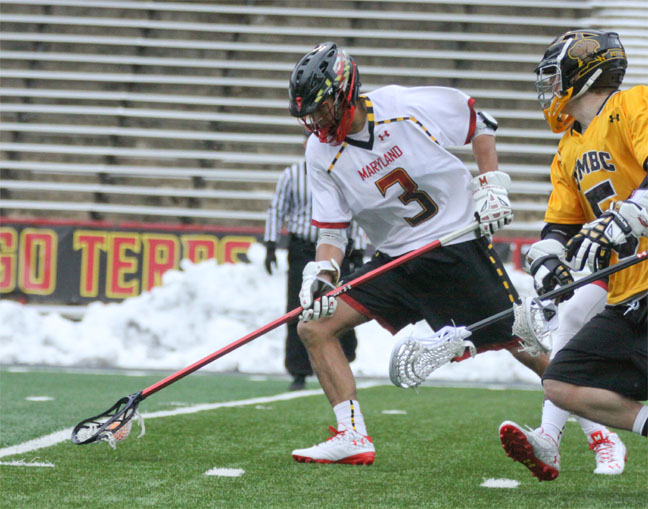 Maryland defenseman casey Ikeda (Conestoga) scoops a groundball (Photo by Rene Schleicher)