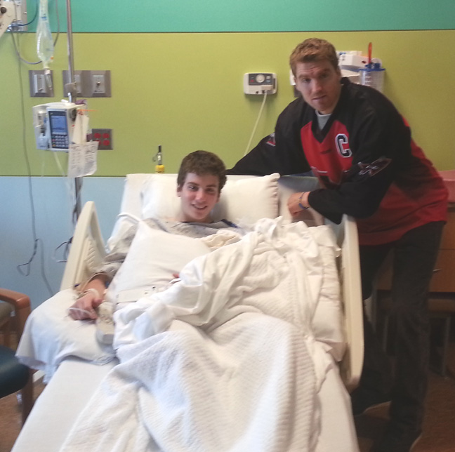 Brodie Merrill visits Josh Cohen after a serious injury