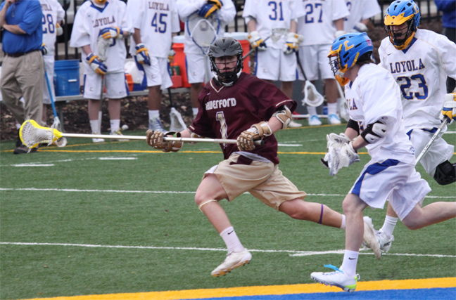 Haverford School defenseman Connor Black scoops a groundball during Wednesday's win