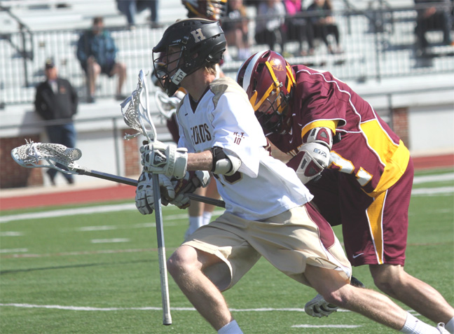 Haverford School's Brendan Jacob (two goals) heads downfield with a defender during Thursday's win over Avon Grove