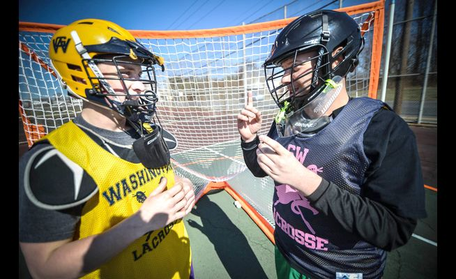 Communication is key: Washington sophomore goalie Paul Thiergartner (right), a student at Rush, has been welcomed by his new teammates. They communicate through fellow goaltender Robert Franklin (left), whose parents and sister are also deaf. MARIA POUCHNIKOVA / TIMES PHOTOS