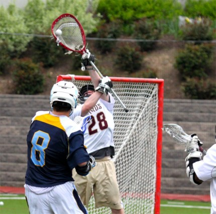 Haverford School goalie Al;ex deMarco makes one of his saix saves in Wednesday's win (Photo for Phillylacrosse.com)