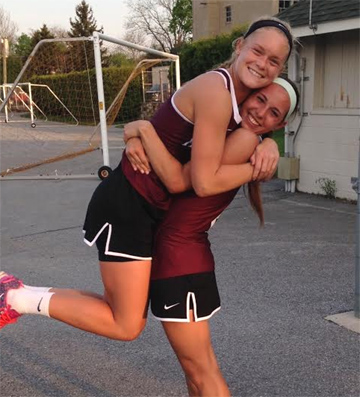 All-time PA scoring leader Katie O'Donnell is lifted by teammate Sara Laudermilch after breaking record Thursday