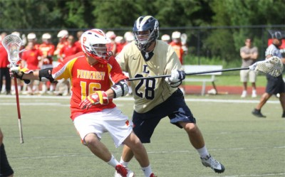 La Salle's Nicholas Buckley defends Will Manganiello (Photo by Rene Schleicher)