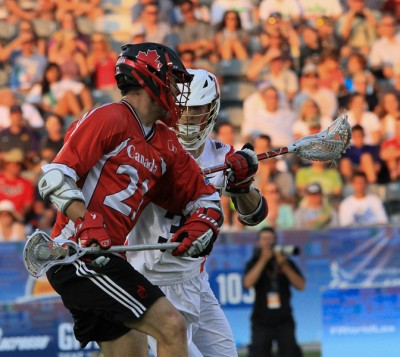 Canada's Kevin Crowley (Fusion Lacrosse, Philadelphia Wings) is defended by Matt Abbott (By John Flickinger)