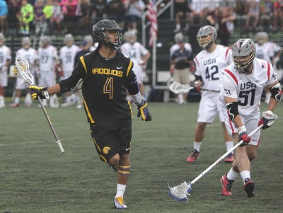 Tucker Durkin (La Salle) defends Lyle Thompson (Photo by John Flickinger)