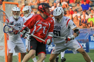 USA All-World defender Tucker Durkin (La Salle) defends Canada's Curtis Dickson (Delaware) in Saturday's game (Photo by John Flickinger)