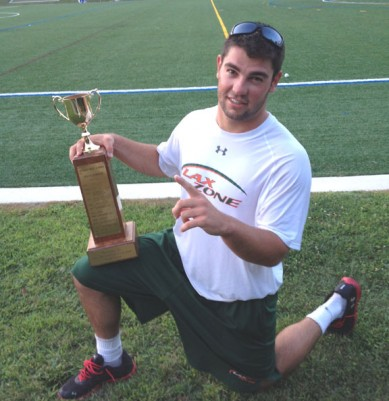Lax Zone's Mark DiFrangia shows off the Millard P. Robinson championship trophy
