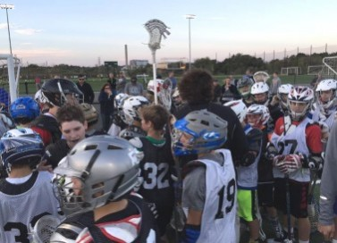 The philly Charity Showdown Middle School tryouts drew 40 7th graders and 70 8th graders Monday at the proving Grounds in Conshohocken. Here the 7th graders surround NXT CEO Andy Hayes