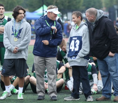 Monmouth sophomore midfielder and Nick Colleluori Aeard winner Zack Schleicher (left), coach Brian Fisher joined 12-year-old Thomas and his father, JT, during the HEADstrong Foundatuion's mid-day ceremony on Saturday