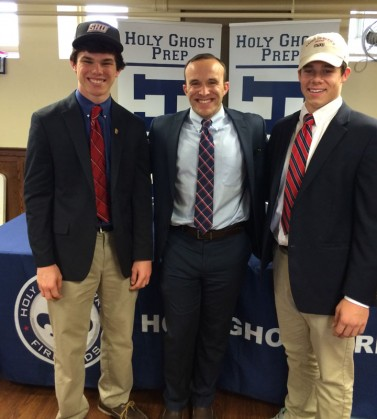 Greg Price (Sacred Heart) and Michael Major (St. Joe's) with Holy Ghost head coach Ryan Tessler after signing their National Letters of Intent Wednesday at Holy Ghost.