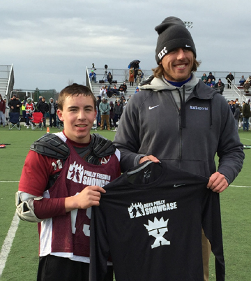 King of the X winner Joe Neuman with Showcase Lacrosse Director Brett Manney