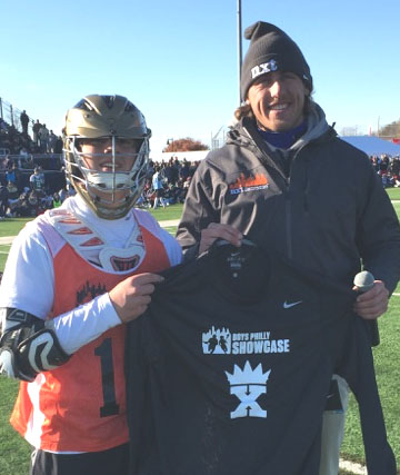 Kyle Prouty, with NXT Showcase Lacrosse Director Brett Manney, wins the King of the X at the Philly Showcase
