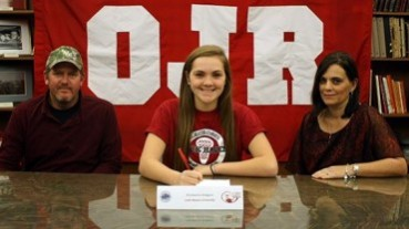 Owen J. Roberts senior Mackenzie Hodgson, flanked by parents Peter and Maggie Hodgson, signs a national letter of intent to accept a Division II women's lacrosse scholarship to Lock Haven University during a recent ceremony at the high school. - See