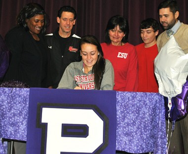 Phoenixville senior Taylor Jefferis signs a national letter of intent to accept a Division II lacrosse scholarship to East Stroudsburg University during a recent ceremony at the school. Also on hand for the event were, standing from left, Senorita Thornton (Phoenixville head coach), Kevin Jefferis (father), Robin Jefferis (mother), Zack Jefferis (brother) and Matt Gionta (Phoenixville athletic director)