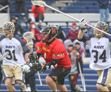 Maryland's Matt Rambo, a La Salle grad who had two goals and one assist, ilooks to maneuver during Saturday's 8-1 in over Navy. Photosby Rene Schleicher