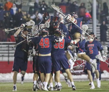 Penn celebrates Tuesday's dramatic OT win (Photo by Rene Schleicher)