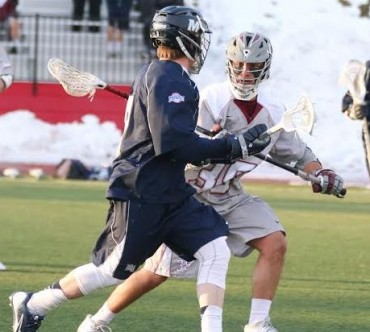 Monmouth's Kevin Murphy is defended by. St. Joe's Charles Giunta - the players were teammates at Penn Charter