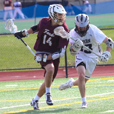 Haverford School's Forry Smith is defended by Will Powers in Tuesday's 15-5 win (Photo for Phillylacrosse.com)