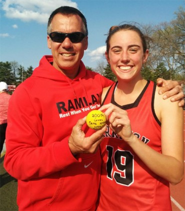 Jane Henderson, flanked by Harriton coach George Dick, scored her 200th career goal on Tuesday.