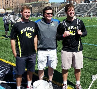 Duke's Pres., Ebe Helm pictured center Congratulates Duke's Middle School Young Guns Coaches , Head Coach Rob Forster and Asst. Coach Jack Forster. Not pictured are Niko Amato, Tucker Durkin & Pete Schwart
