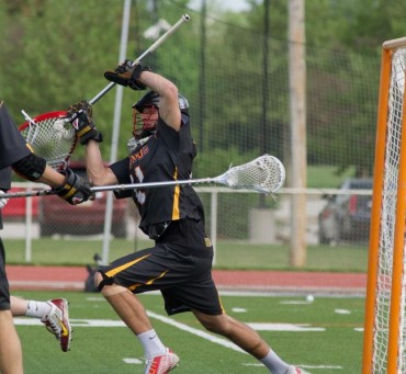 Ursinus goalie Brian Neff (16 saves) make one of his stops in Saturday's overtime loss to Gettysburg