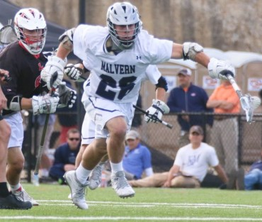 Malvern prep's Charles Kelly wins one of his 17 face-offs during Wednesday's 11-6 quarterfinals win over Lawrenceville School