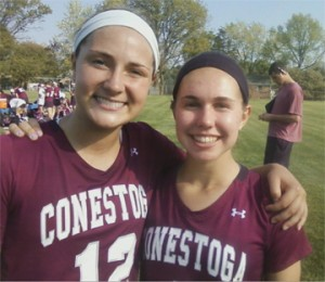Conestoga captains Sarah Nicholson (left) and Maggie Stetson after 18-6 win at Springfield (Delco) to win Central League
