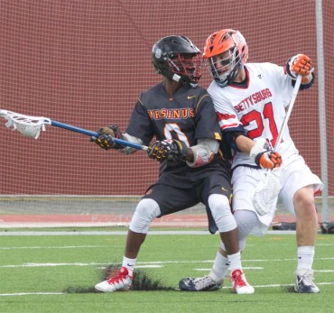 Ursinus' Gerard Brown is defended by Nick Alibrandi during Saturday's loss to Gettysburg (Photo for Phillylacrosse.com)