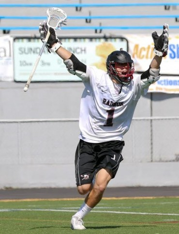 Jack Wilson celebrates the game-winning goal for Radnor in Saturday's PIAA championship win over St. Joseph's Prep, 11-10, in overtime (Photo by Rene Schleicher)