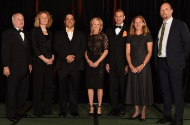 2015 National Lacrosse Hall of Fame Inductees (L-R): Bob Hartranft, Maggie Vaughan, Dom Fin, Julie Hull Elicker, Charlie Lockwood, Sarah Nelson, Brian Voelker. Not pictured: Jake Curran, Diane Geppi-Aikens.
