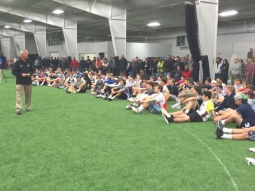Denver coach Bill Tierney addresses the players at the Philly Showcase Kickoff Friday night