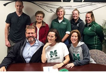 Methacton senior Deb Peifer, seated between parents Eddie and Maryann Peifer, signs a national letter of intent to accept a Division I lacrosse scholarship from Manhattan College during a recent ceremony at the high school. Also on hand for the event, top from left, are Kevin Peifer (brother), Ann Peifer (grandmother), Methacton head coach Laurie Markle, Methacton coach Catie Sobotor and Methacton coach Casey Leap. (Photo courtesy of PAC-10Sports.com)