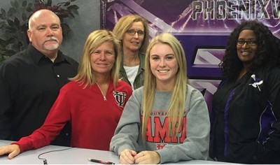 Phoenixville defender Jacy Sterritt signed a National Letter of Intent to play Division II lacrosse at the University of Tampa during a recent ceremony at the high school. Also on hand for the event were, standing from left, father Kevin Sterritt, mother Jen Foresta, Dynamite club coach Maureen Burger and Phoenixville head coach Aamina Thornton.