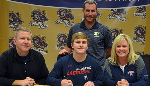 Spring-Ford senior Kevin Todd, flanked by parents Mark and Kim Todd, signs a national letter of intent to accept a Division I lacrosse scholarship from the University of Richmond during a recent press conference at the high school that was also attended by Spring-Ford coach Kevin Donnelly.