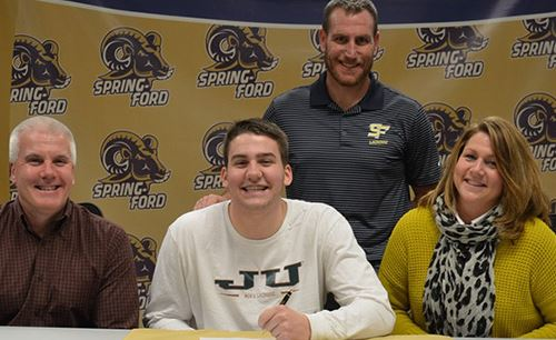 Spring-Ford senior Liam Hare, flanked by parents Steve and Maria Hare, signs a national letter of intent to accept a Division I lacrosse scholarship from Jacksonville University during a recent press conference at the high school that was also attended by Spring-Ford coach Kevin Donnelly.