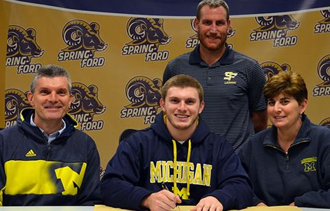Spring-Ford senior Matt DellaCroce, flanked by parents Bob and Stephanie DellaCroce, signs a national letter of intent to accept a Division I lacrosse scholarship from the University of Michigan during a recent press conference at the high school that was also attended by Spring-Ford coach Kevin Donnelly.