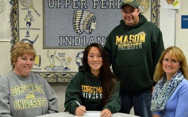 Upper Perkiomen senior Morgan Rynn signs a national letter of intent to accept a Division I lacrosse scholarship from George Mason (Va.) University during a recent press conference at the school that was also attended, from left, mother Donna Rynn, father Frank Rynn and Upper Perkiomen coach Susan Flack.
